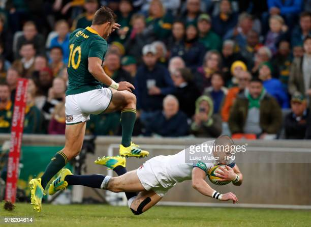 Mike Brown of England dives over to score the opening try during the Rugby Union tour match between South Africa and England at Toyota Stadium on...