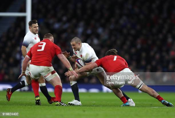 Mike Brown of England is challenged by Samson Lee and Josh Navidi of Wales during the NatWest Six Nations round two match between England and Wales...