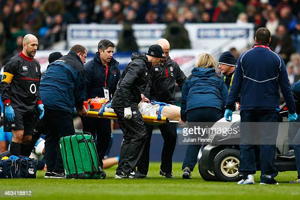 Mike Brown of England is stretchered off during the RBS Six Nations match between England and Italy at Twickenham Stadium on February 14 2015 in...
