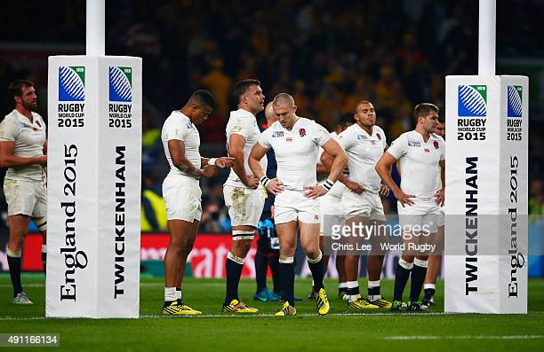 Mike Brown of England looks dejected with team mates during the 2015 Rugby World Cup Pool A match between England and Australia at Twickenham Stadium...