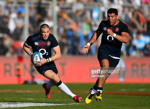 Mike Brown of England makes a break with Ellis Genge of England in support during the ICBC Cup match between Argentina and England at the Estadio San...
