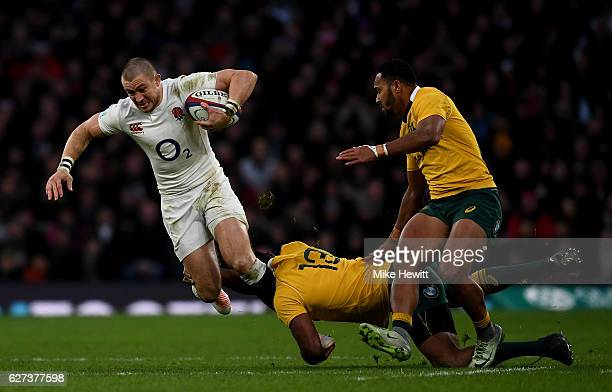 Mike Brown of England tackled by Tevita Kuridrani of Australia during the Old Mutual Wealth Series match between England and Australia at Twickenham...