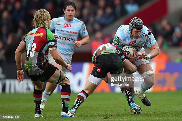 Mike Brown of Harlequinns tackles Dan Lydiate of Racing Metro 92 during the Heineken Cup Pool 4 round 4 match between Harlequins and Racing Metro 92...