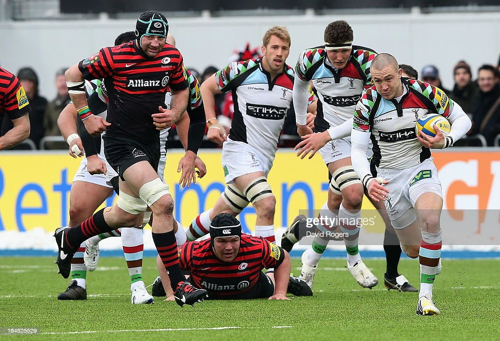 Mike Brown of Harlequins breaks with the ball during the Aviva Premiership match between Saracens and Harlequins at Allianz Park on March 24, 2013 in Barnet, England.