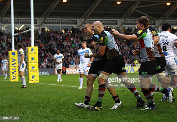 Mike Brown of Harlequins celebrates with his team mates after scoring a try during the Aviva Premiership match between Harlequins and Exeter Chiefs...