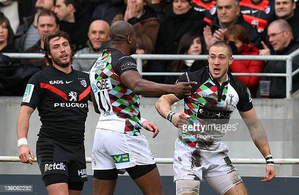 Mike Brown of Harlequins celebrates with team mate Ugo Monye after scoirng the first try during the Heineken Cup match between Toulouse and...