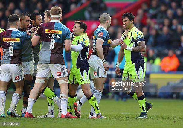 Mike Brown of Harlequins confronts Denny Solomona of Sale Sharks after a tackle which left team mate Nick Evans of Harlequins not playing any futher...