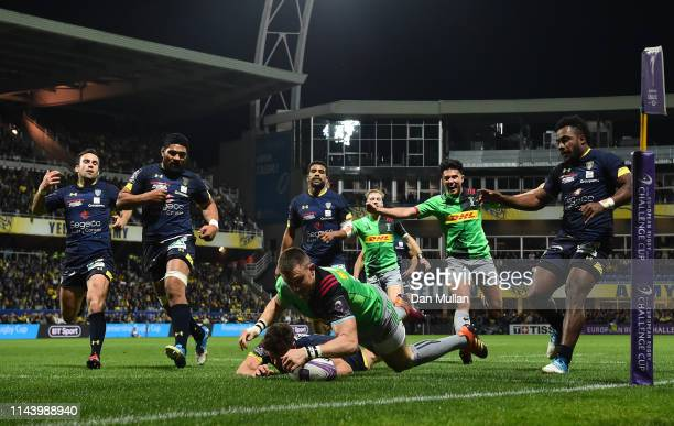 Mike Brown of Harlequins dives over to score his side's first try during the European Challenge Cup Semi Final match between Clermont Auvergne and...