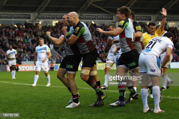 Mike Brown of Harlequins is congratulated by George Robson after scoring a try during the Aviva Premiership match between Harlequins and Exeter...