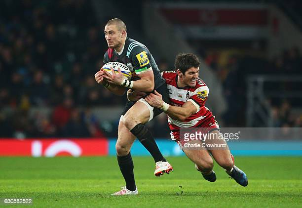 Mike Brown of Harlequins is tackled by James Hook of Gloucester during the Aviva Premiership Big Game 9 match between Harlequins and Gloucester Rugby...