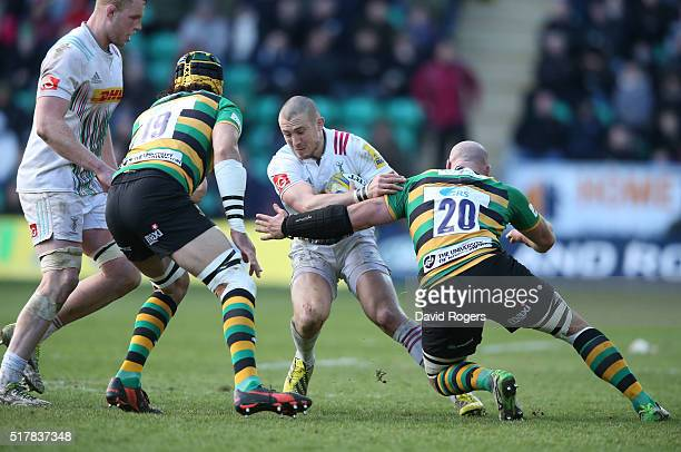 Mike Brown of Harlequins is tackled by Sam Dickinson during the Aviva Premiership match between Northampton Saints and Harlequins at Franklin's...