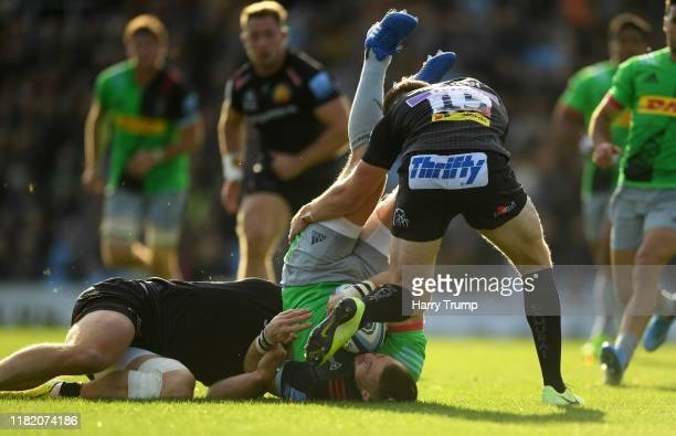 Mike Brown of Harlequins looks to break past the tackle from Sam Simmonds of Exeter Chiefs during the Gallagher Premiership Rugby match between...
