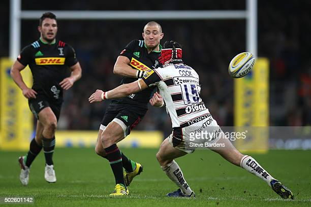 Mike Brown of Harlequins passes as he is tackled by Rob Cook of Gloucester during the Aviva Premiership 'Big Game 8' match between Harlequins and...