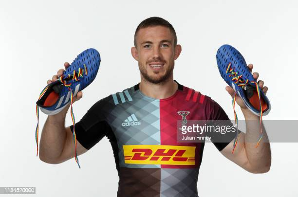 Mike Brown of Harlequins poses for a portrait with rainbow laces on his boots in support of the Stonewall Rainbow Laces Campaign promoting equality...
