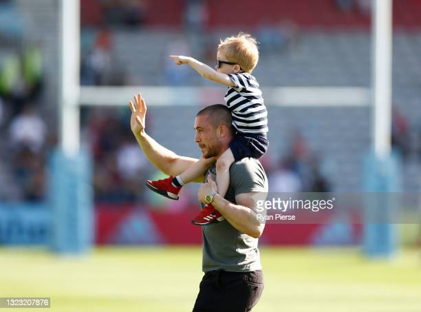 Mike Brown of Harlequins reacts with his son after a presentation to mark the end of his Harlequins career during the Gallagher Premiership Rugby...