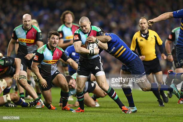 Mike Brown of Harlequins surges through the challenge of Rob Kearney of Leinster during the European Rugby Champions Cup Pool Two match between...