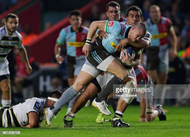 Mike Brown of Harlequins tackled by Hikairo Forbes of La Rochelle during the European Rugby Champions Cup match between Harlequins and La Rochelle at...