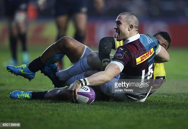 Mike Brown of Quins celebrates scoring a try during the European Rugby Challenge Cup match between Harlequins and Timisoara Saracens at Twickenham...