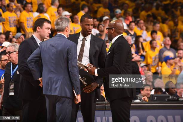 Mike Brown of the Golden State Warriors huddles up with his staff during Game One of the Western Conference Semifinals against the Utah Jazz during...