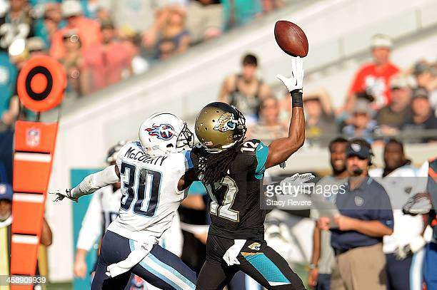Mike Brown of the Jacksonville Jaguars is unable to catch a pass in front of Jason McCourty of the Tennessee Titans during a game at EverBank Field...