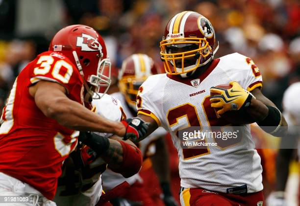 Mike Brown of the Kansas City Chiefs tackles Clinton Portis of the Washington Redskins during their game October 18 2009 at FedEx Field in Landover...