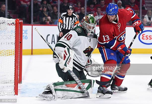 Mike Brown of the Montreal Canadiens attempts to deflect the puck against Devan Dubnyk of the Minnesota Wild in the NHL game at the Bell Centre on...