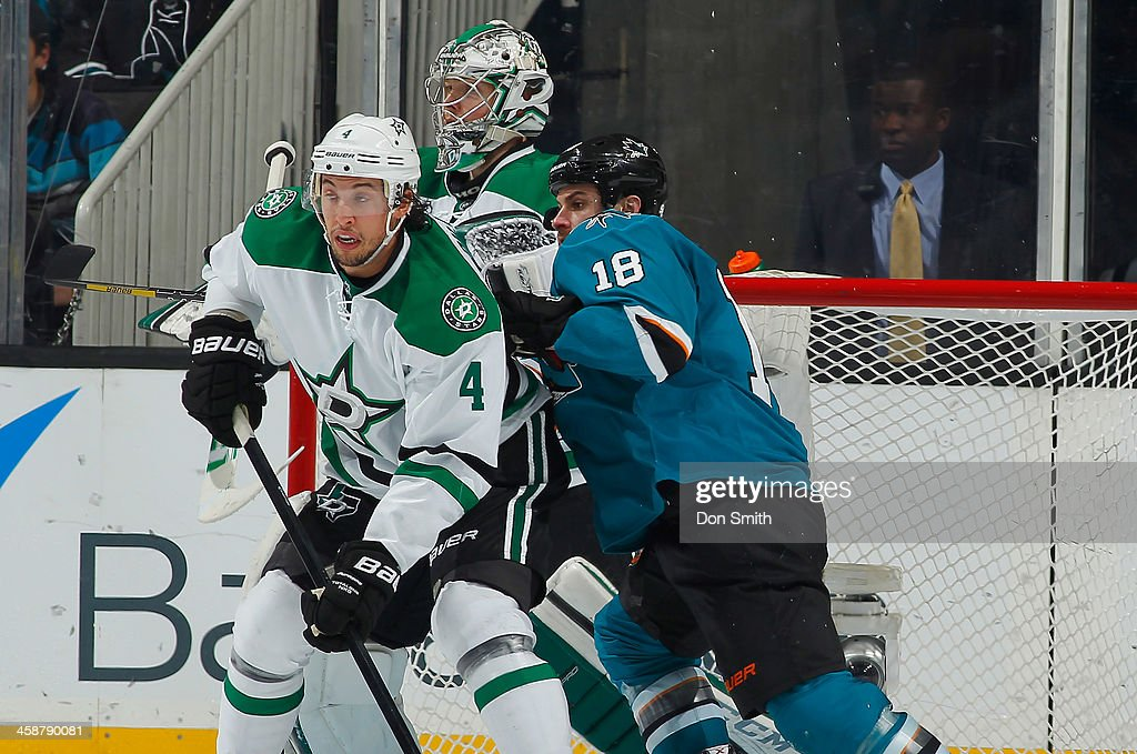 Mike Brown #18 of the San Jose Sharks battles to get in front of the net against Kari Lehtonen #32 and Brenden Dillon #4 of the Dallas Stars during an NHL game on December 21, 2013 at SAP Center in San Jose, California.