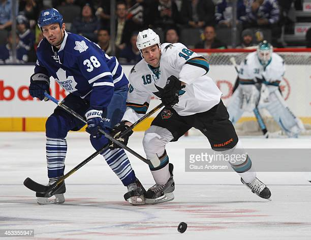 Mike Brown of the San Jose Sharks skates against Frazer McLaren of the Toronto Maple Leafs during an NHL game at the Air Canada Centre on December 3...