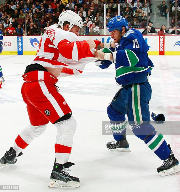 Mike Brown of the Vancouver Canucks and Darren McCarty of the Detroit Red Wings fight during their game at General Motors Place on November 2 2008 in...
