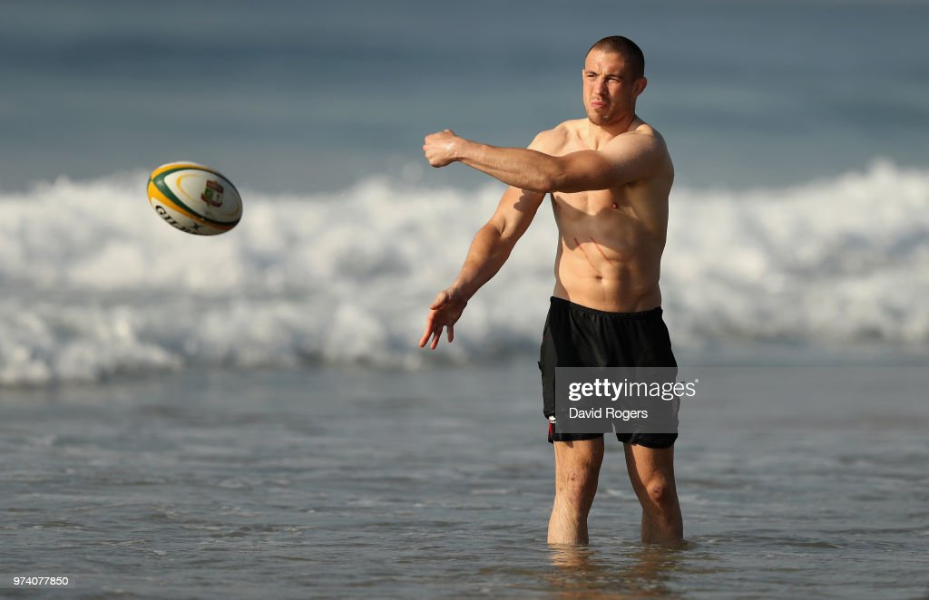 Mike Brown passes the ball during the England recovery session held on the beach on June 14, 2018 in Umhlanga Rocks, South Africa.