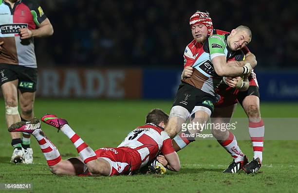 Mike Brown the Harlequins fullback is tackled during the Aviva Premiership match between Gloucester and Harlequins at Kingsholm Stadium on March 29...