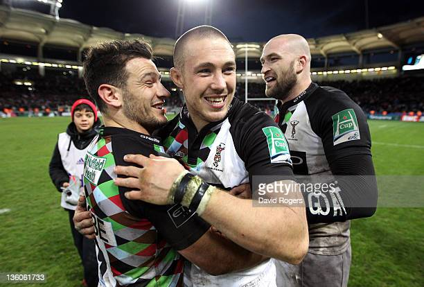 Mike Brown who scored two tries celebrates with team mates Danny Care after their victory during the Heineken Cup match between Toulouse and...