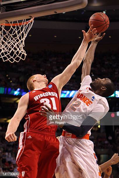 Mike Bruesewitz of the Wisconsin Badgers fights for the loose ball against Baye Keita of the Syracuse Orange during their 2012 NCAA Men's Basketball...