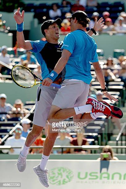 Mike Bryan and Bob Bryan celebrate match point against Vasek Pospisil of Canada and Jack Sock during the doubles final on day 13 of the Miami Open...