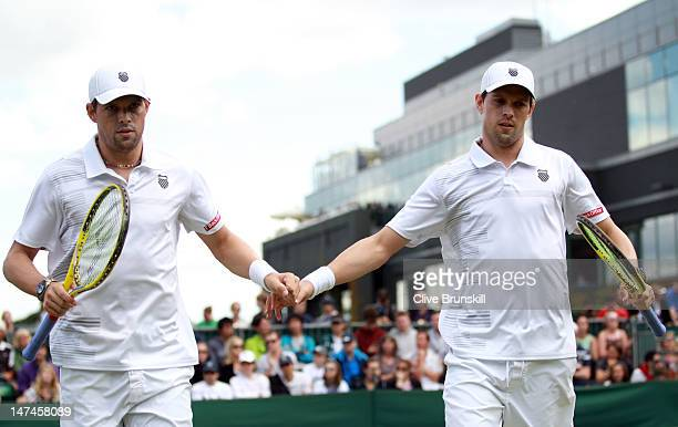 Mike Bryan and Bob Bryan in action during their Gentlemen's Doubles second round match against Jamie Delgado and Kenneth Skupski of Great Britain on...