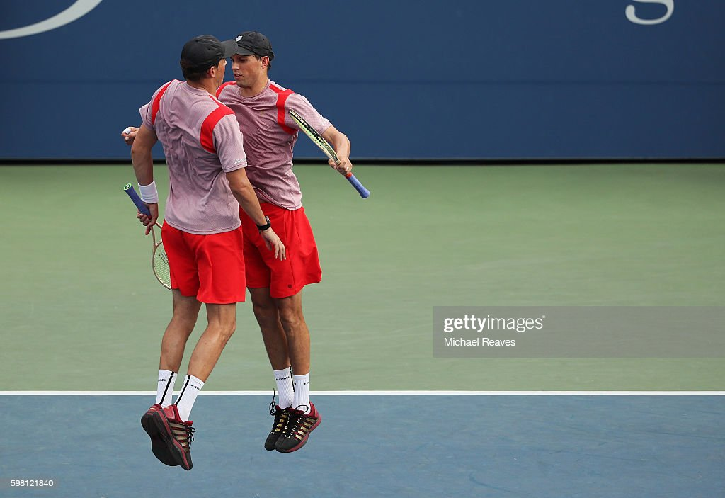 Mike Bryan and Bob Bryan of the United States celebrate their victory over Martin Klizan of Slovakia and Adil Shamasdin of Canada during his first round Men's Doubles match on Day Three of the 2016 US Open at the USTA Billie Jean King National Tennis Center on August 31, 2016 in the Flushing neighborhood of the Queens borough of New York City.