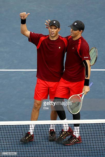 Mike Bryan and Bob Bryan of the United States in action against David Marrero and Fernando Verdasco of Spain during his third round Men's Singles...
