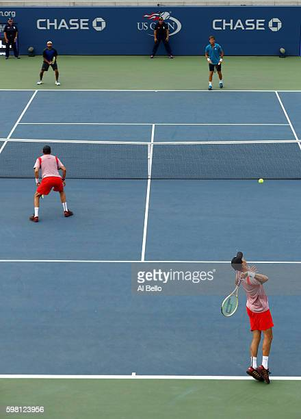 Mike Bryan and Bob Bryan of the United States in action against Martin Klizan of Slovakia and Adil Shamasdin of Canada during their first round Men's...
