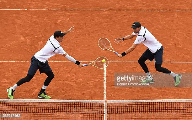 Mike Bryan and Bob Bryan of the United States in action during the Men's Doubles semi final match against Lukasz Kubot of Poland and Alexander Peya...