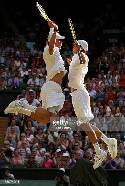 Mike Bryan and Bob Bryan of the United States of America bump chests as they celebrate match point during their Gentlemen's Doubles final match...