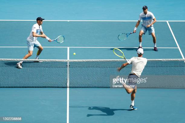 Mike Bryan and Bob Bryan of the United States play in their Men's Doubles third round match against Ivan Dodig of Croatia and Filip Polasek of...