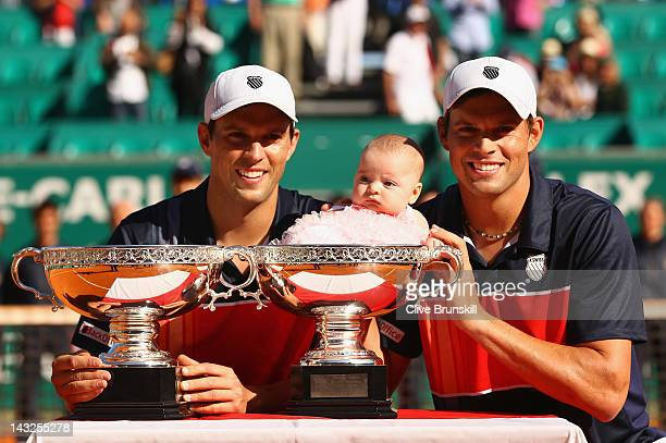 Mike Bryan and Bob Bryan of the USA and Bobs daughter Micaela sits in one of the winners trophies after victory in the doubles final against Max...