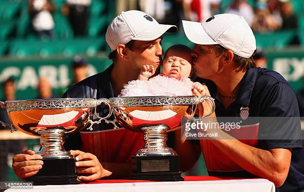 Mike Bryan and Bob Bryan of the USA kiss Bobs daughter Micaela after victory in the doubles final against Max Mirnyi of Belarus and Daniel Nestor of...