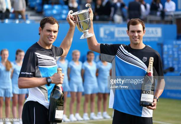 Mike Bryan and Bob Bryan of the USA lift the trophy after victory in the Men's Doubles final against Alexander Peya of Austria and Bruno Soares of...