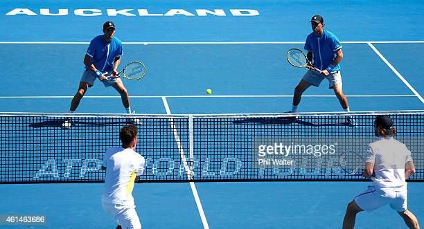 Mike Bryan and Bob Bryan play a return during their doubles match against Andre Begemann of Germany and Robin Haase of the Netherlands during day two...