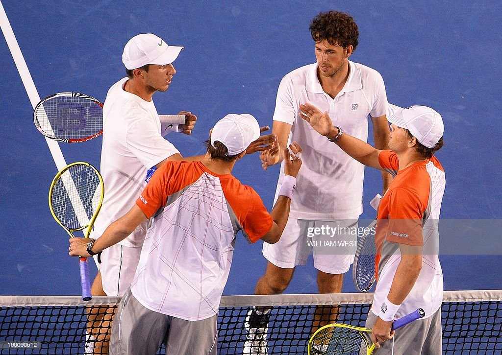 Mike Bryan (lower R) and his brother Bob (lower L) of the US shake hands with the Netherland's Robin Haase (upper R)and Igor Sijsling after their victory during the men's doubles final on day 13 of the Australian Open tennis tournament in Melbourne early on January 27, 2013.