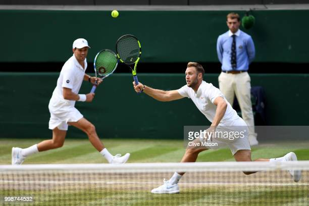 Mike Bryan and Jack Sock of The United States return against Raven Klaasen of South Africa and Michael Venus of New Zealand during the Men's Doubles...