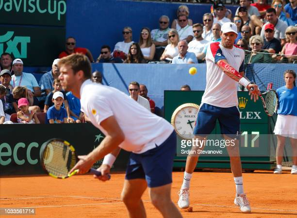 Mike Bryan and Ryan Harrison of USA compete in the doubles match against Ivan Dodik and Mate Pavic of Croatia during day two of the Davis Cup World...
