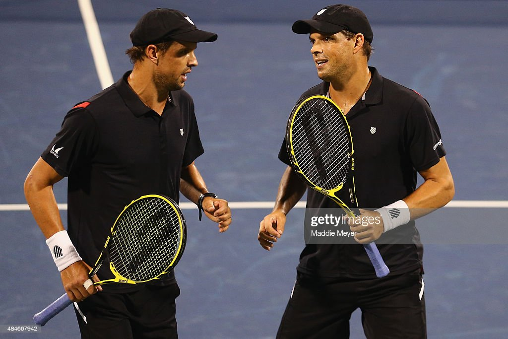Mike Bryan, left, and Bob Bryan talk between games during their match against Juan Sebastian Cabal and Robert Farah of Columbia on Day 6 of the Western & Southern Open at the Lindner Family Tennis Center on August 20, 2015 in Cincinnati, Ohio.