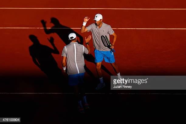 Mike Bryan of the United States and Bob Bryan of the United States celebrate a point during the Men's Doubles Final against Ivan Dodig of Croatia and...